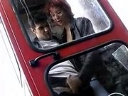 Woman Gives A Handjob In A Phone Booth
