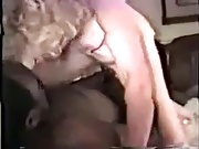 A wife getting serviced, (quality not great)