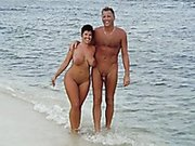 This woman seems to be obsessed with her hubby's hard cock on the beach