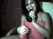 Barely legal busty brunette babe fucks her snatch with a beer bottle