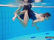Teen girl Avenna is swimming in the pool