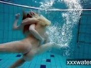 """Milana and Katrin strip eachother underwater"""