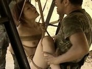 Asian slut hanging on some ropes fucked by the soldiers