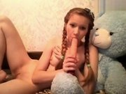 Cutie __Bars___ plays with a dildo