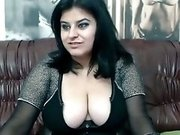 Raven haired whore with huge melons loves playing with her dildos