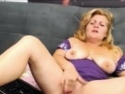 busty blonde mature masturbates with yellow sextoy