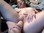 Chubby mature chick fucks a huge toy