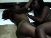 Two very sexy ebony sluts are in a hotel room and they are