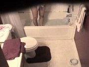 Voyeur video of a naked girl bathing