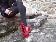 Laura XXX on high heels and stockings sitting and walking