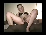 Mature black slut takes it in her ass