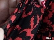 Mature licks a condom and fingers herself