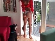 Emily Ratajkowski in a red shirt and white thong
